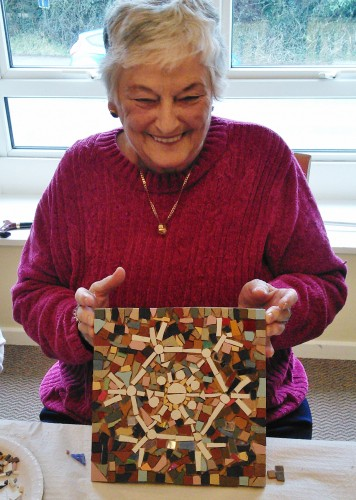Marlborough group member with finished mosaic artwork