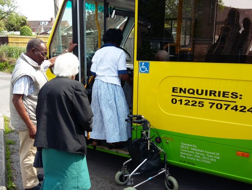 Members being collected by a community bus