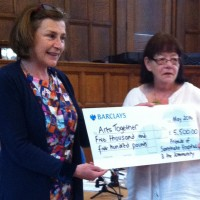 Julia accepting a cheque for £5000 from the Friends of Savernake Hospital