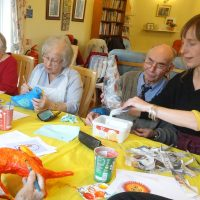 Artist, Hannah working with group members in Marlborough