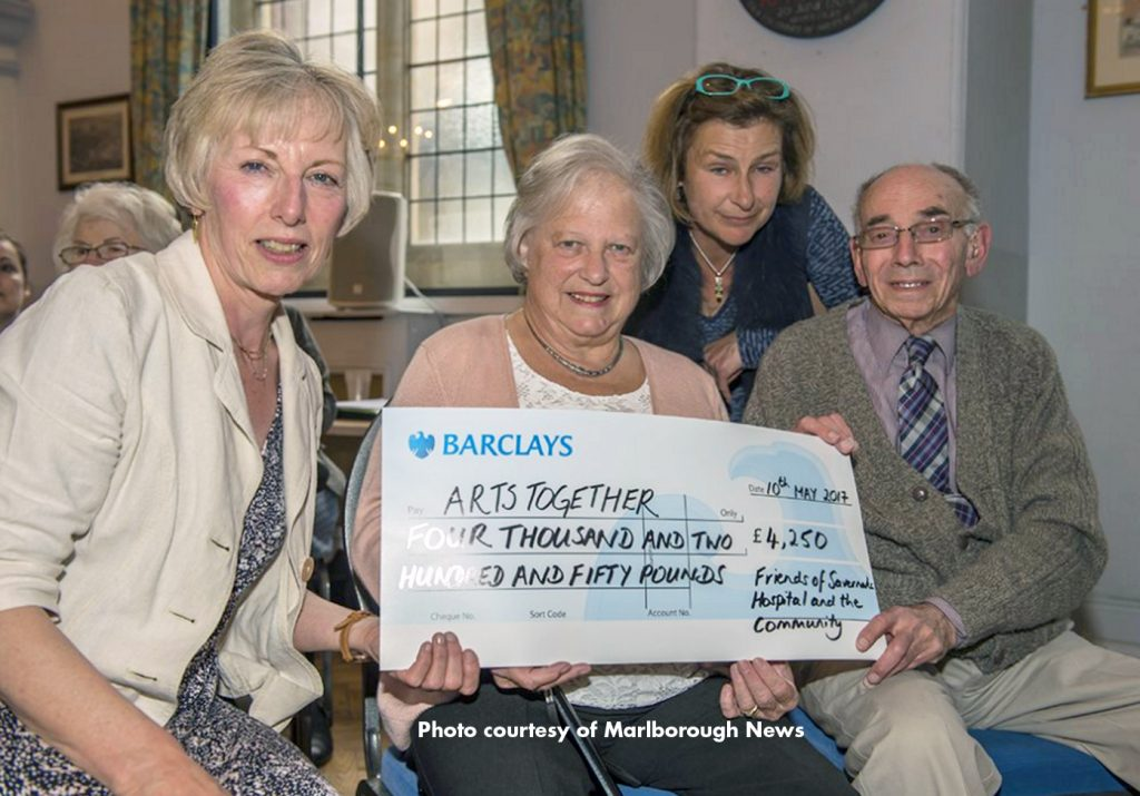 A cheque being presented by the Friends of Savernake Hospital