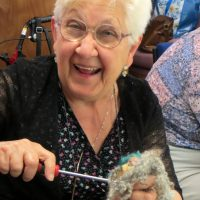 A Corsham group member is brandishing a screw driver during a puppet making session