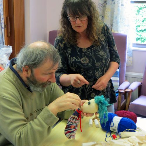 Sewing up a puppets head in Corsham