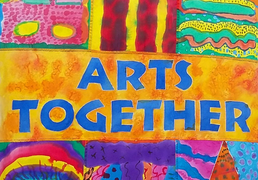 detail of silk painted banner with the words Arts Together