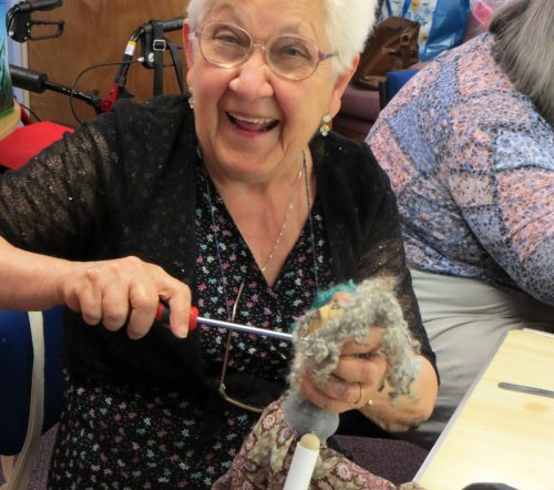Pewsey members weilds a screwdriver during the puppet making sessions